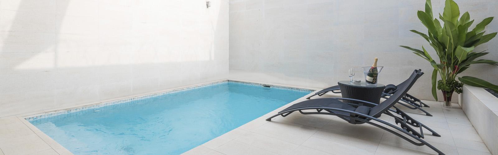 slider-piscina-magno-suites-malabo